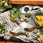 鮎の塩焼きの石庭造りの写真