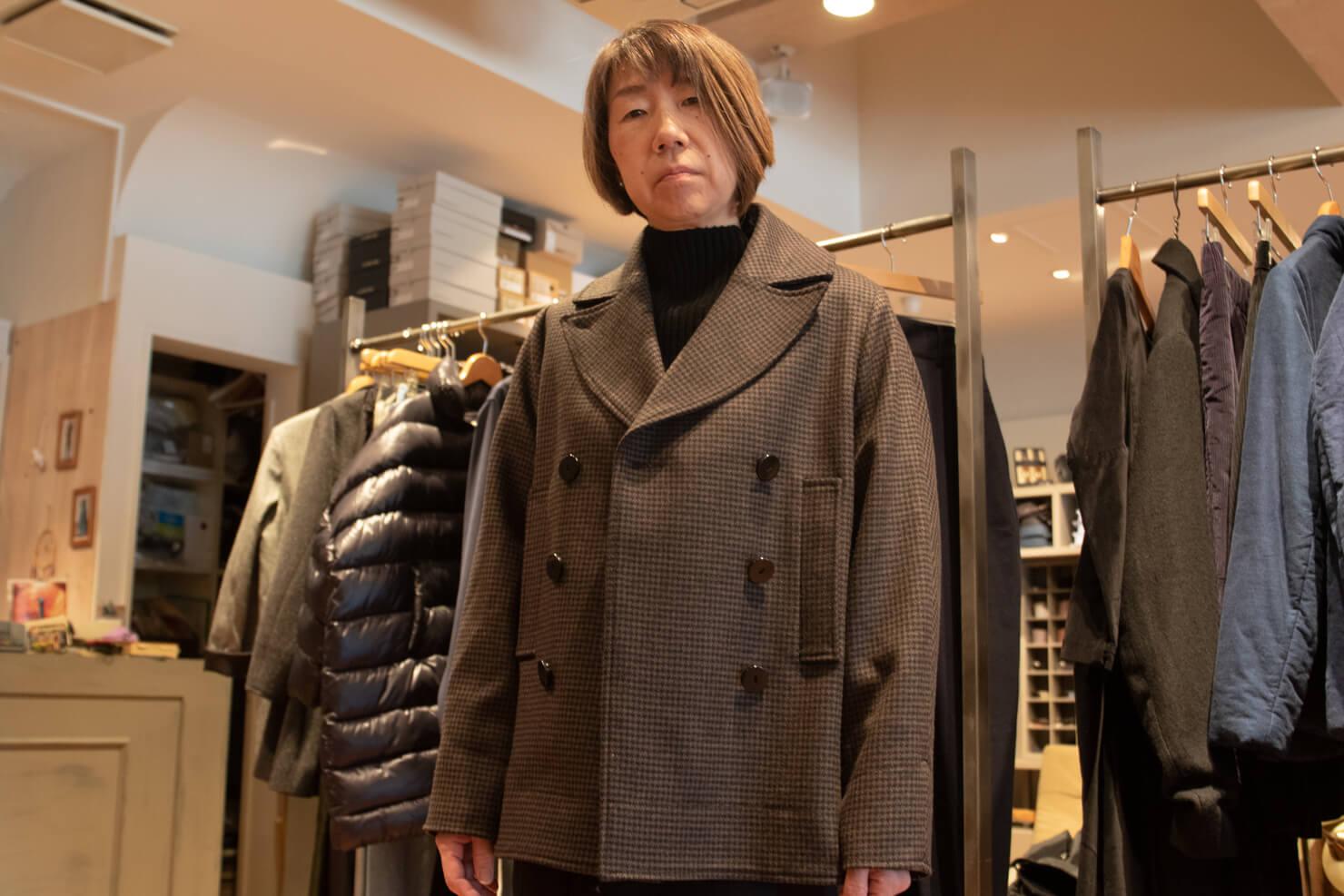 スタジオニコルソンのPコートを着たガッツの写真