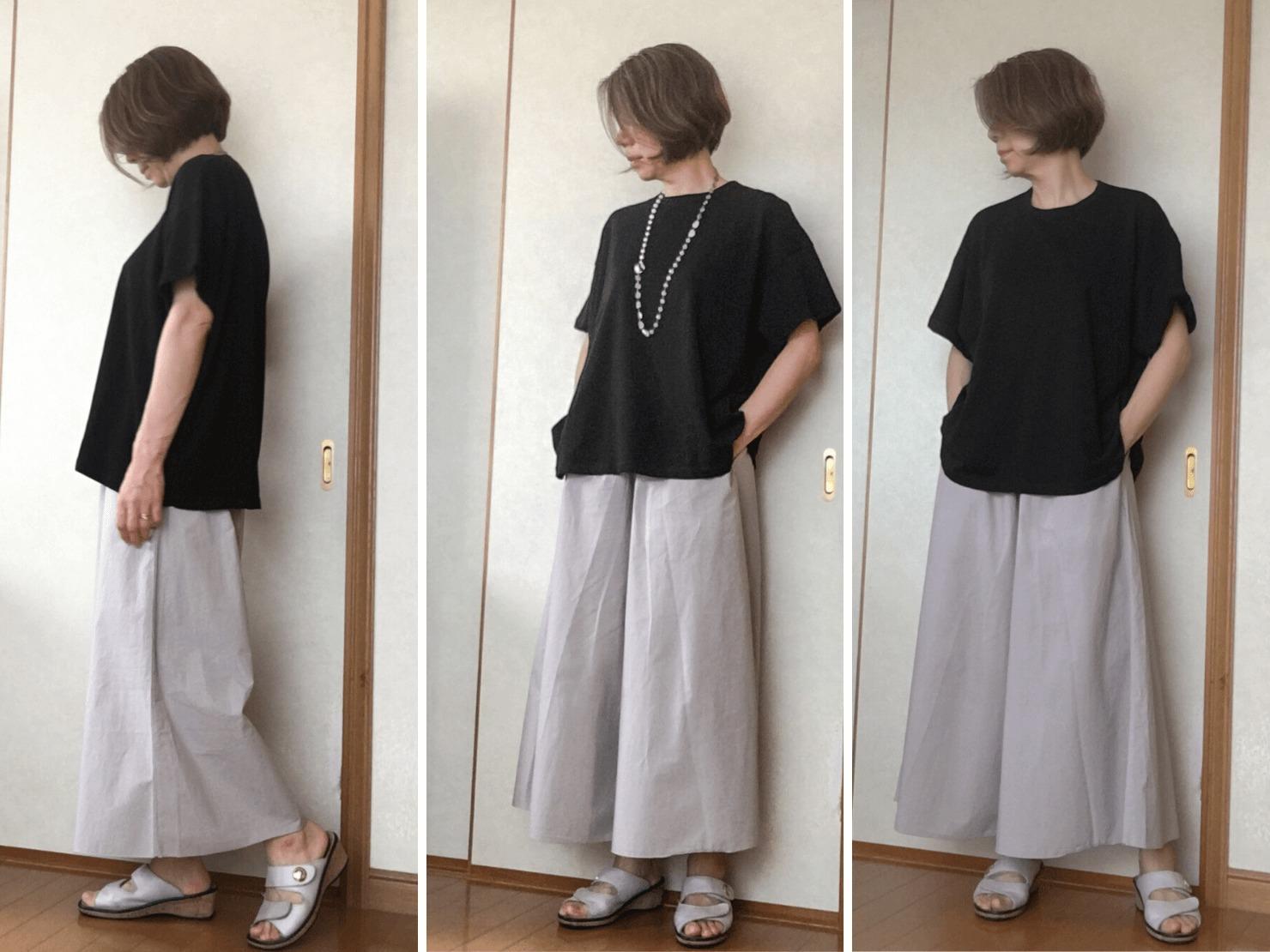 黒いTシャツとワイドパンツのコーディネートの写真