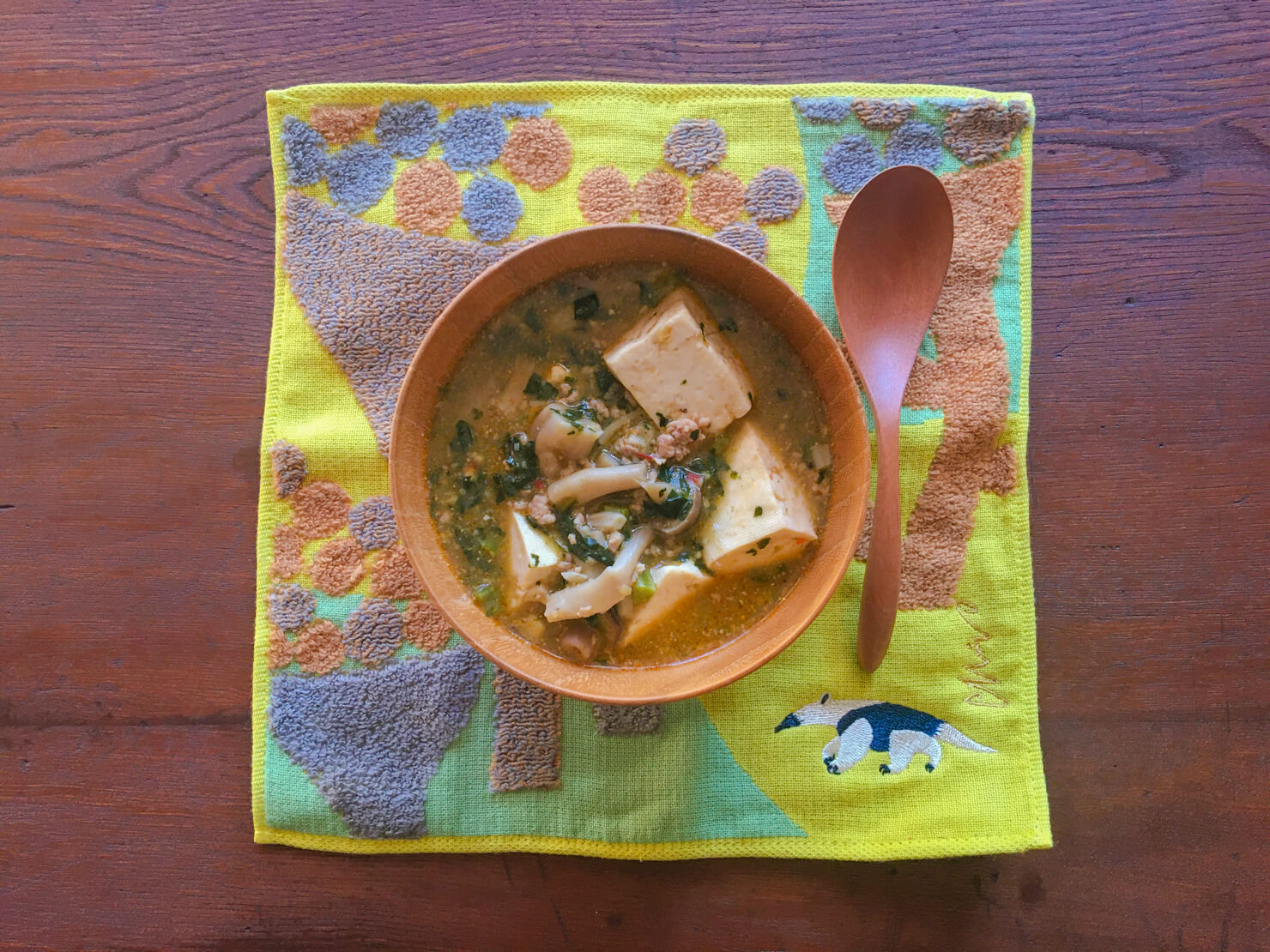 カーボロネロと豆腐の坦々煮込みの写真